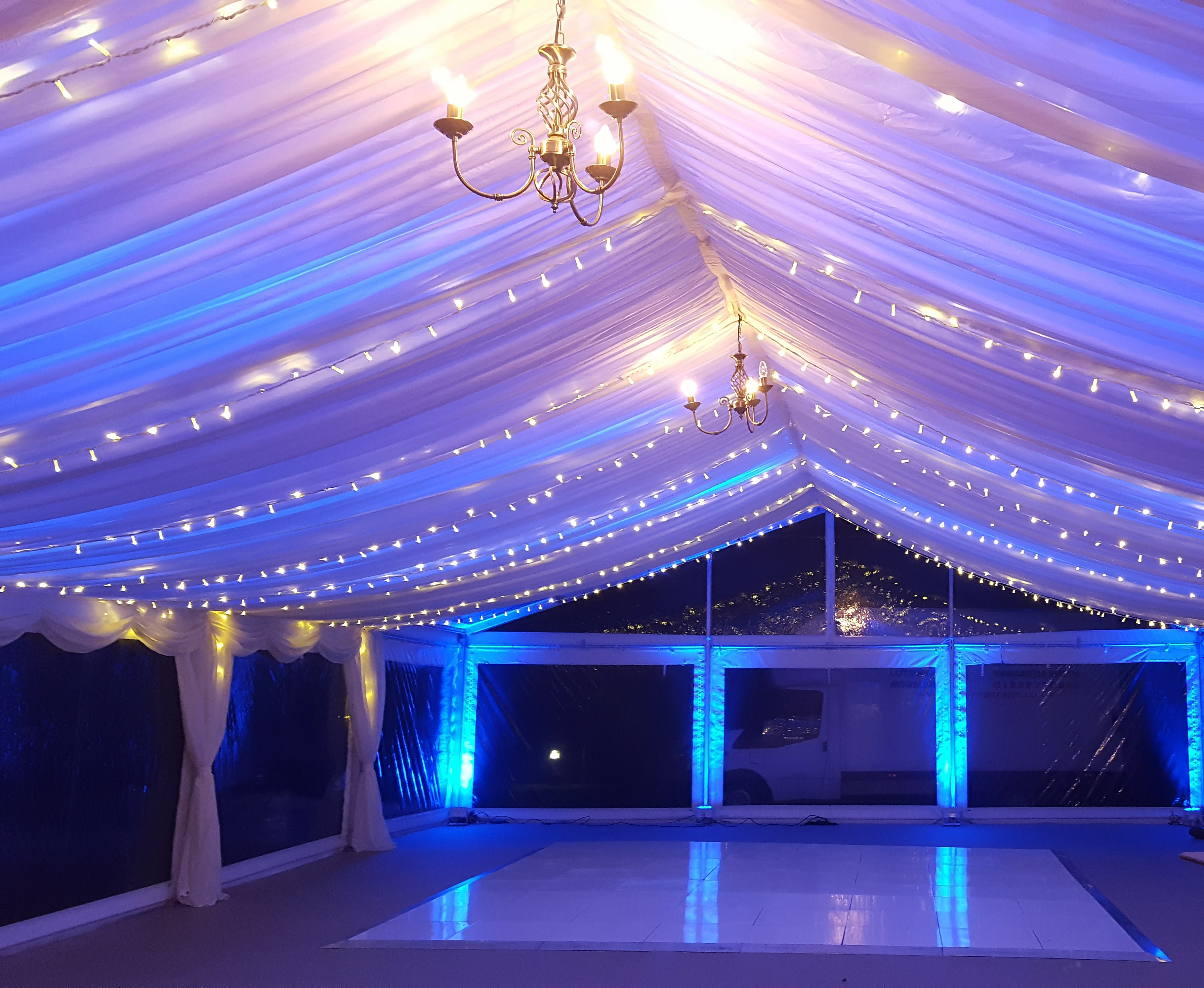 fairy lighting and colour wash in wedding marquee